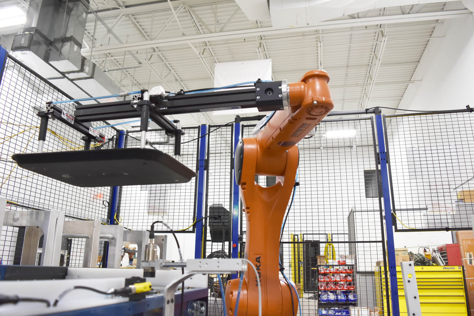 Large Kuka robot working at a production line