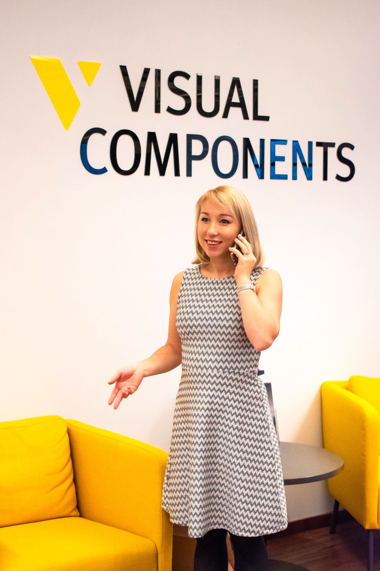 Administrative Coordinator Valeria on the phone at Visual Components