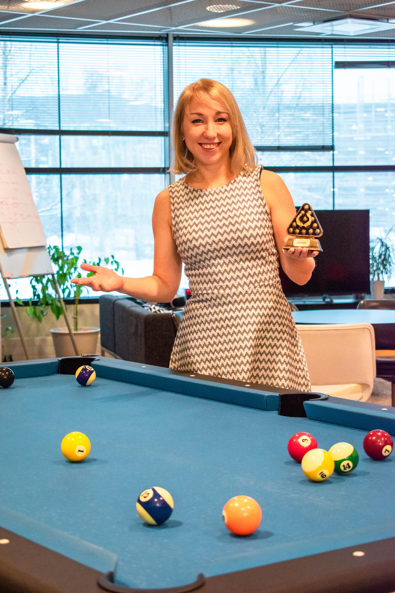 Administrative Coordinator Valeria showing her pool victory prize