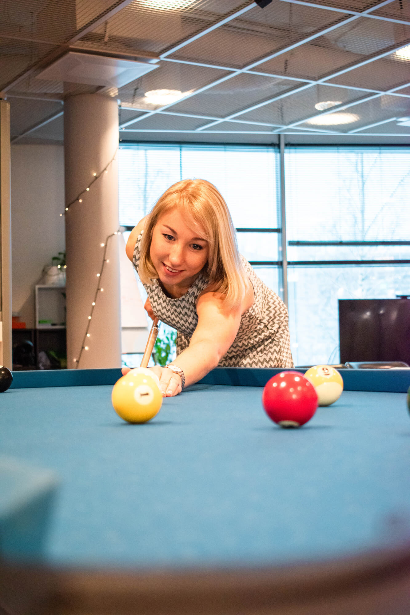 Administrative Coordinator Valeria playing pool