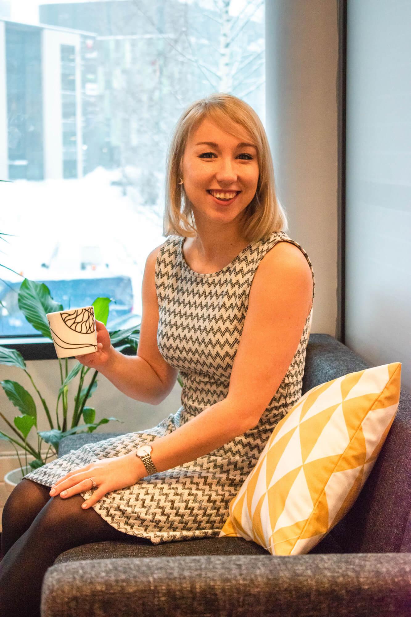 Administrative Coordinator Valeria smiling on coffee break