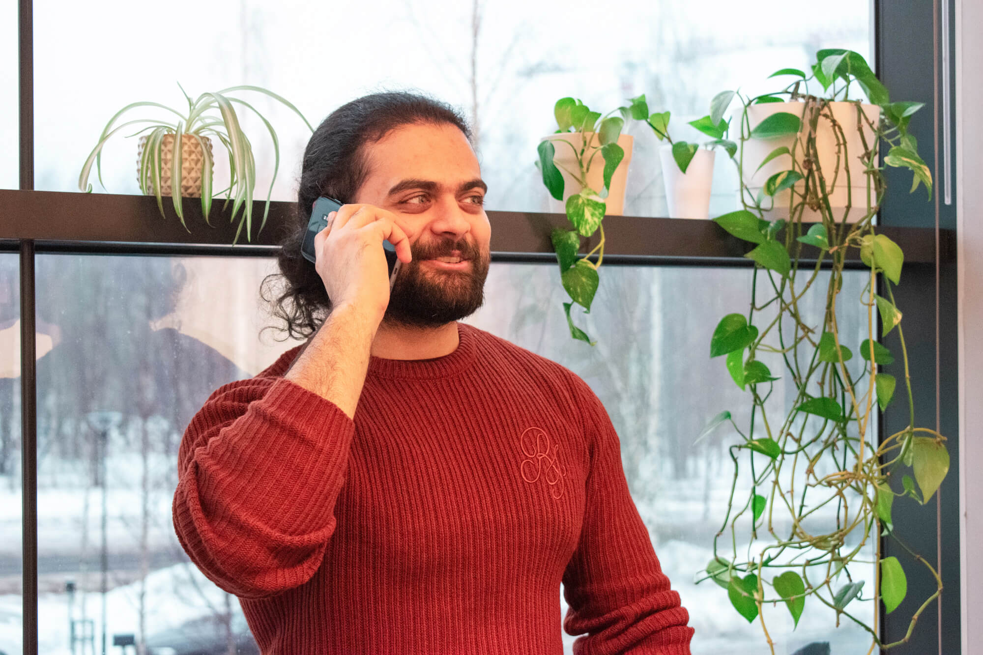 Sales Coordinator Mustafa on the phone