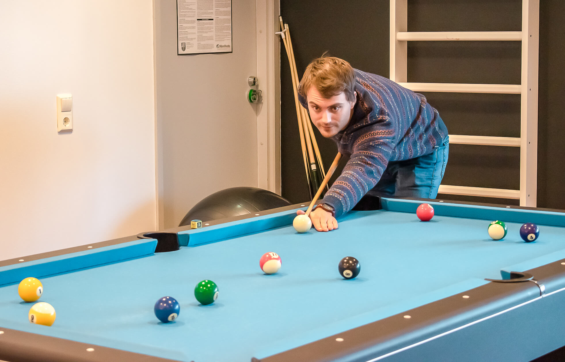 Application Engineer Joel playing pool during a break