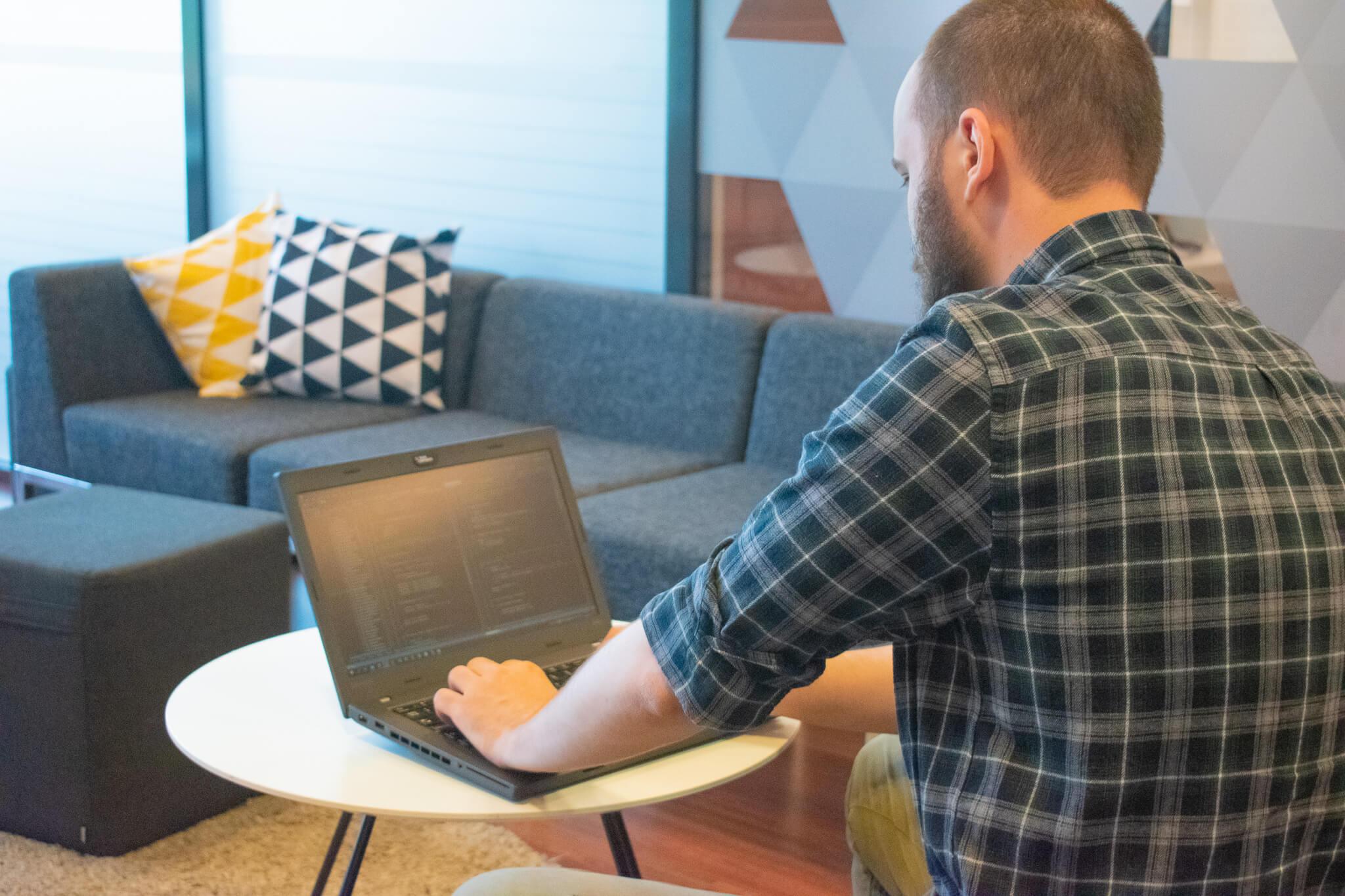 Developer Jevgeni working on simulation software on a laptop