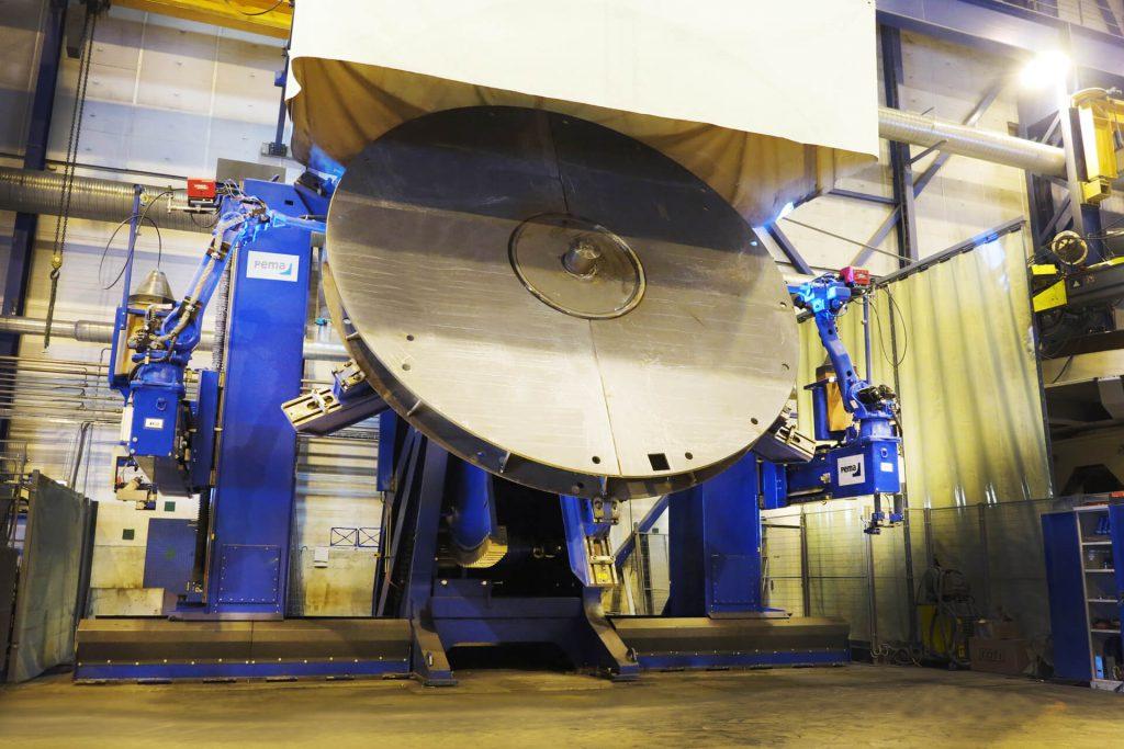 robots welding a big piece of equipment